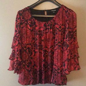 Classy layered dress shirt.